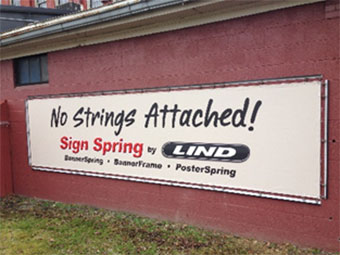 Banner hung by the Lind SingSpring installation system