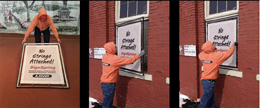 Hanging a banner to a window using the Lind SignSpring system